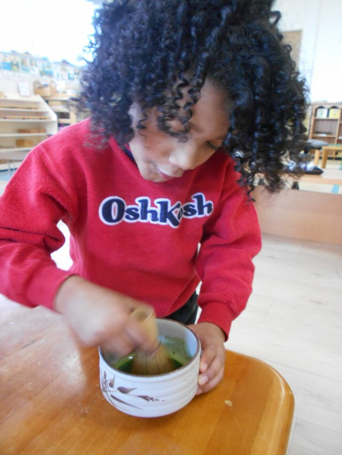 Our Little Sous Chef whisking up a cup of Matcha