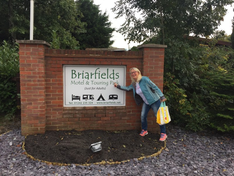 Michel next to the briarfield caravan park sign in Cheltenham