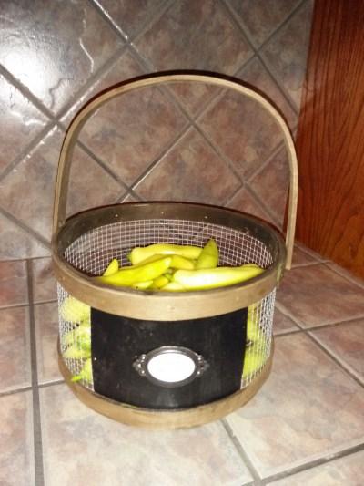 banana peppers in metal basket