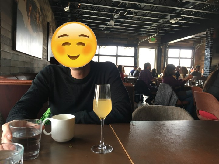 Mr ONL enjoying coffee AND a mimosa at brunch, because we know how to party