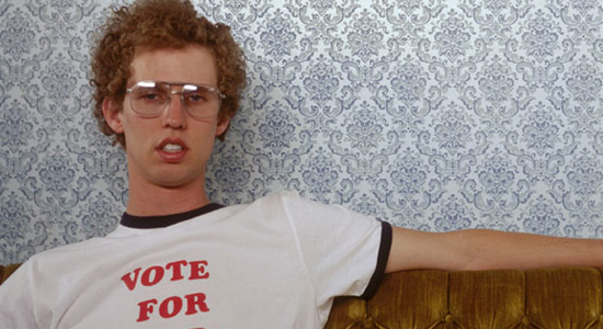 Napoleon Dynamite sitting on couch