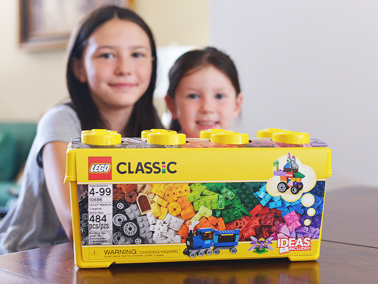 4 and 11 year old with LEGO set
