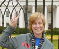 Cindy Sheehan gives the peace sign in front of the White House on Nov. 7, 2006. (Photo courtesy of Ben Schumin)