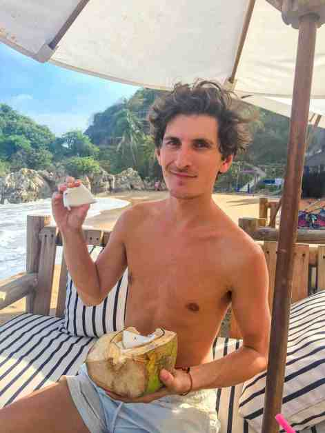 Eating fresh Coconut at Zipolite