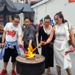 Worshipers lighting incense at Jade Temple Shanghai