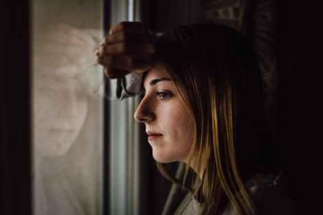 woman leaning on glass window measure your progress