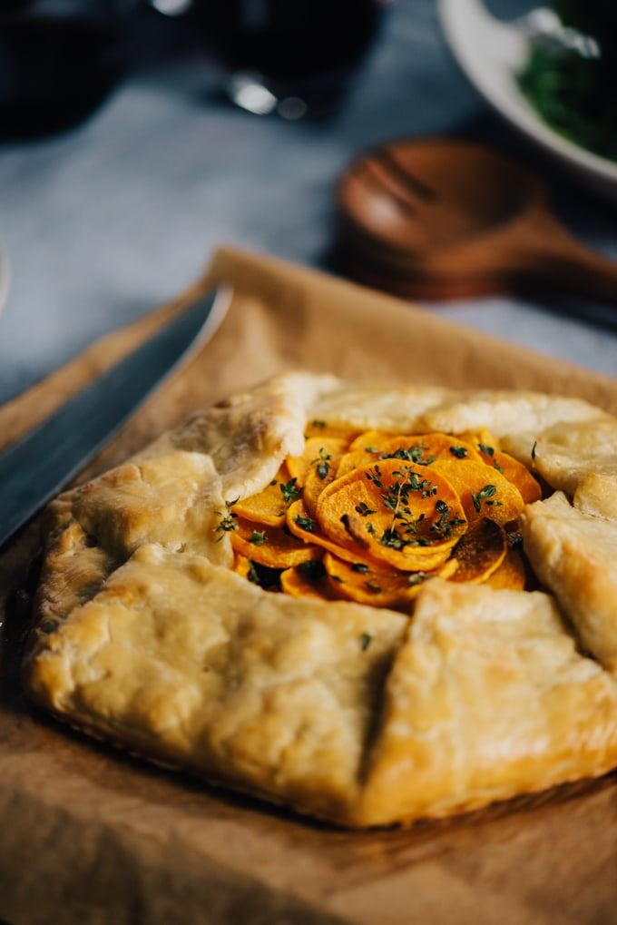 Butternut squash galette is one of my favorite ways to showcase this sweet, nutritious fall vegetable. This galette is sweet, nutritious, and hearty, and a gorgeous centerpiece for a gathering with friends. #vegetarian #wholefood #realfood #butternutsquash
