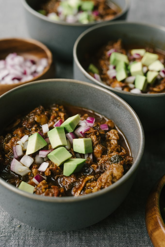 This recipe for chili con carne is a rich and bone-warming addition to your cold weather rotation.This version is slowly simmered with poblanos, jalapeños, and an adjustable spice blend until the meat is fall-apart tender. It's a paleo and whole 30 compliant crowd-pleaser! #wholefood #realfood #paleo #whole30