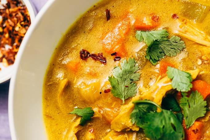 The tang and spice of fresh turmeric root really shines in this easy weeknight turmeric chicken stew. It's a delicious twist on classic chicken soup that uses leftover chicken, lots of fresh vegetables, chicken bone broth, and a spiced turmeric coconut milk. It's naturally gluten-free, paleo, and whole 30 compliant.