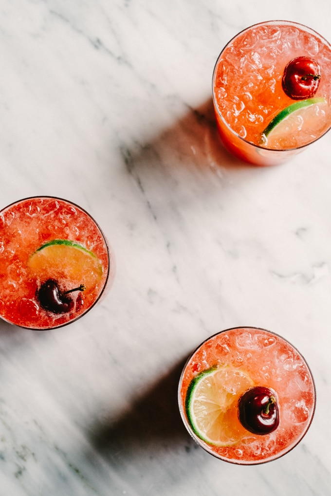 This Cherry Gin Rickey is liquid summer. It's a tart and refreshing summer cocktail with the perfect amount of sweet. You can easily make a large batch, so grab a few friends and get your rickey on.