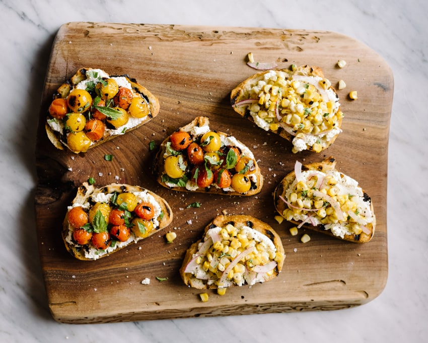 Ricotta toast is my go-to summer meal. It's fast, easy, and seriously delicious. While just about anything works as a topping, my favorites are burst tomatoes with basil, and roasted corn salsa with red onion and oregano.