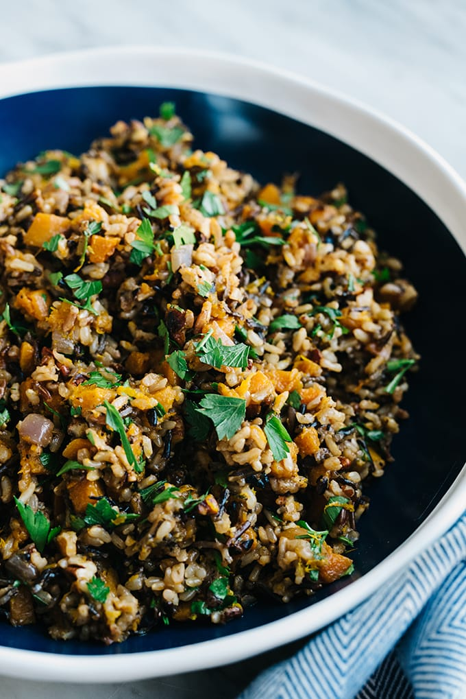 I love having grain salads or pilafs on hand for an easy, seasonal side dish or meal prep lunch option. This butternut squash rice pilaf recipe is sweet, nutty, and super easy. #vegan #vegetarian #butternutsquash #wholefoods #realfood