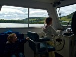 Isabella steering the boat looking or Nessie