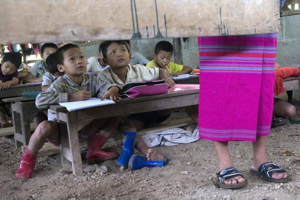 Children attend a school in Mae La refugee camp which is