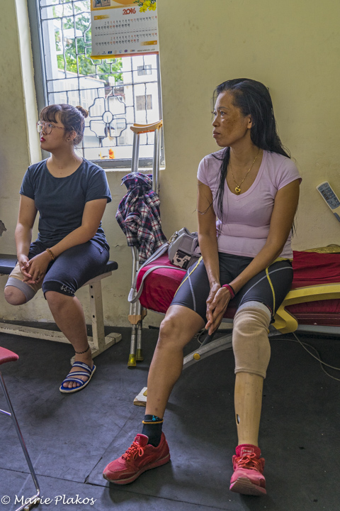 Nguyen and companion in the gym