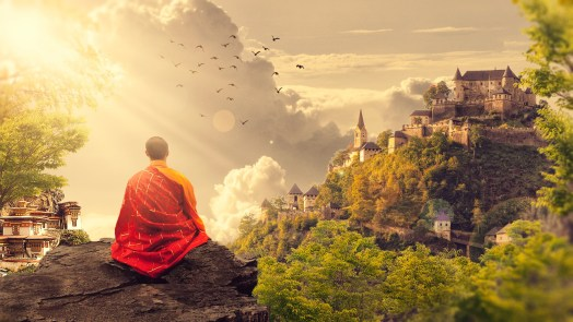 Buddhist monk looking over at the mountain