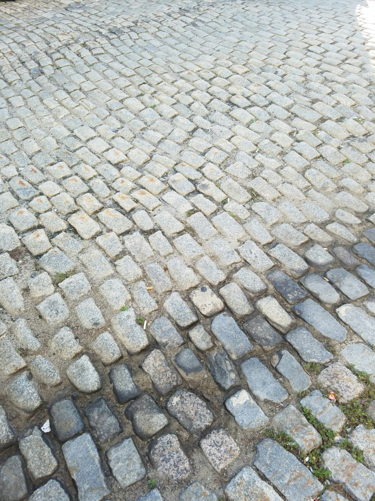 Cobblestone streets serve as a reminder of Portland's colonial past