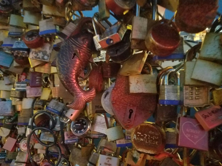 People hook padlocks of all shapes and sizes to this fence along the wharf to profess their love to someone