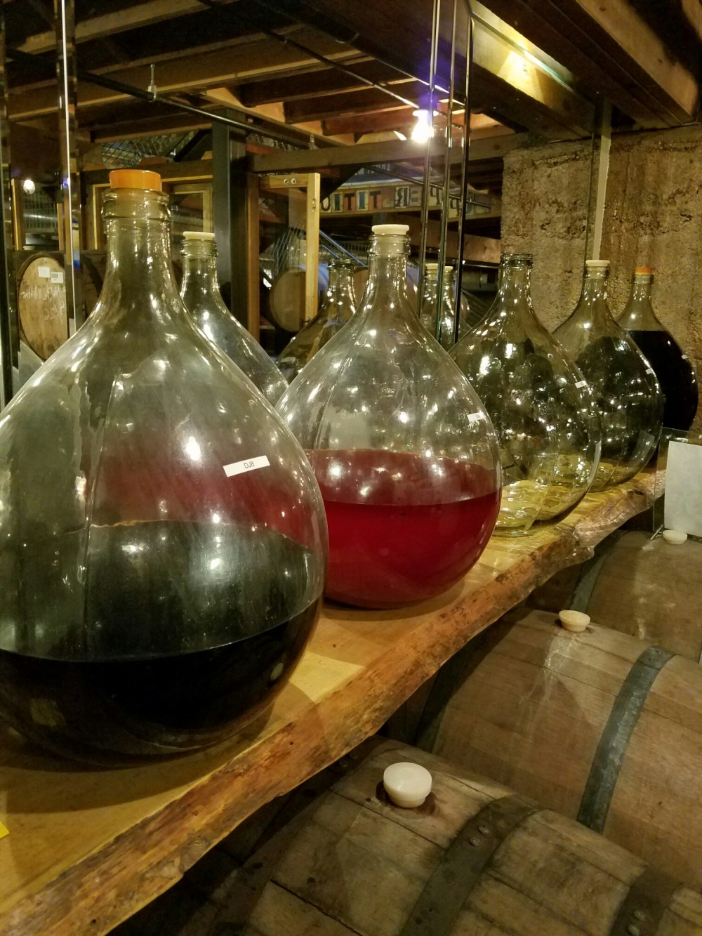 Demijohns used to sample new varietals at Superstition Meadery