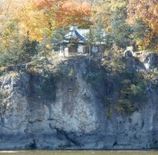 Across the river was this scenic view of cliffs, colors, and a home perched up high.
