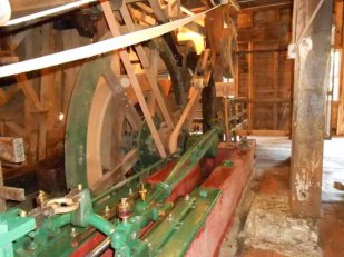 Belts whirred through pulleys, driving the millstone.