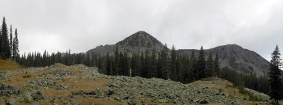 The trail opened up, showing more of the surrounding peaks.