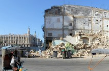 The old building on this corner collapsed. It and the one in the background are across the street from El Capitolio.