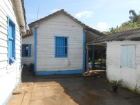 The mother and grandmother of the farmer lived next door. Several small buildings made up the home.