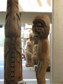 Kwakwaka carving style - deeply carved figures, exaggerated features