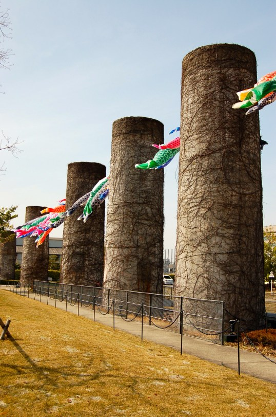 Old chimneys decorated with colourful carp streamers to mark the celebration of Kodomo No Hi (children's day) in May