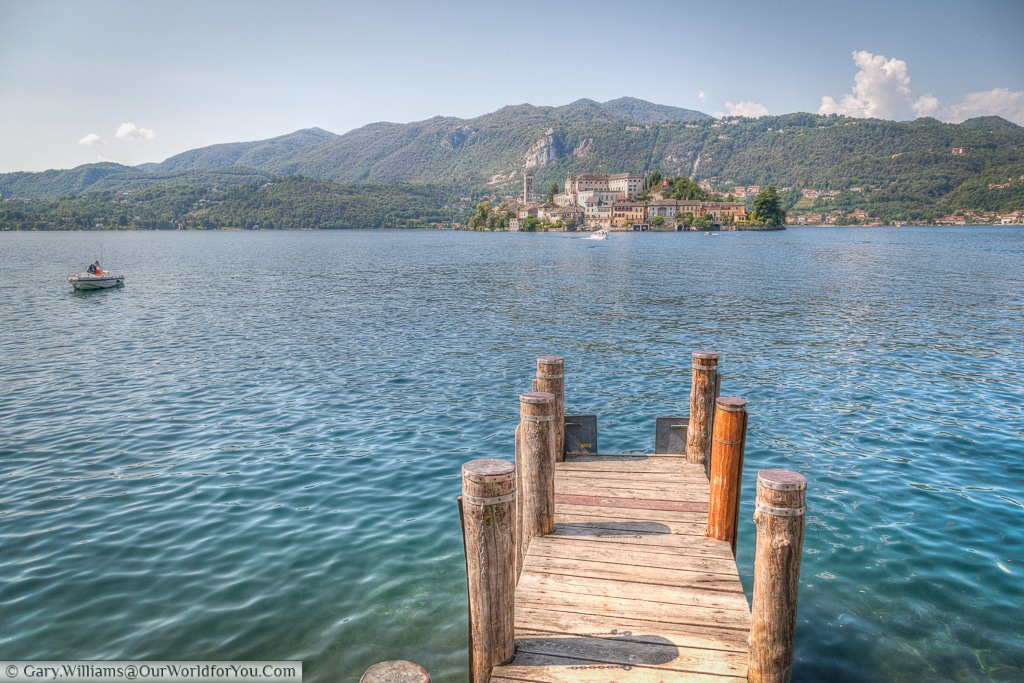 The view from the lakeside to the small island of Isola San Giulio on Lake Orta, Italy
