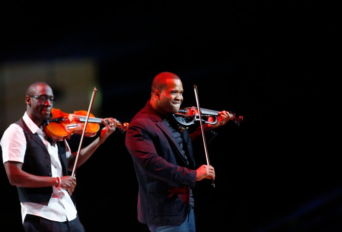 Black Violin perform at the Kids Inaugural concert for children and military families, one of the events ahead of the second-term inauguration of U.S. President Barack Obama in Washington