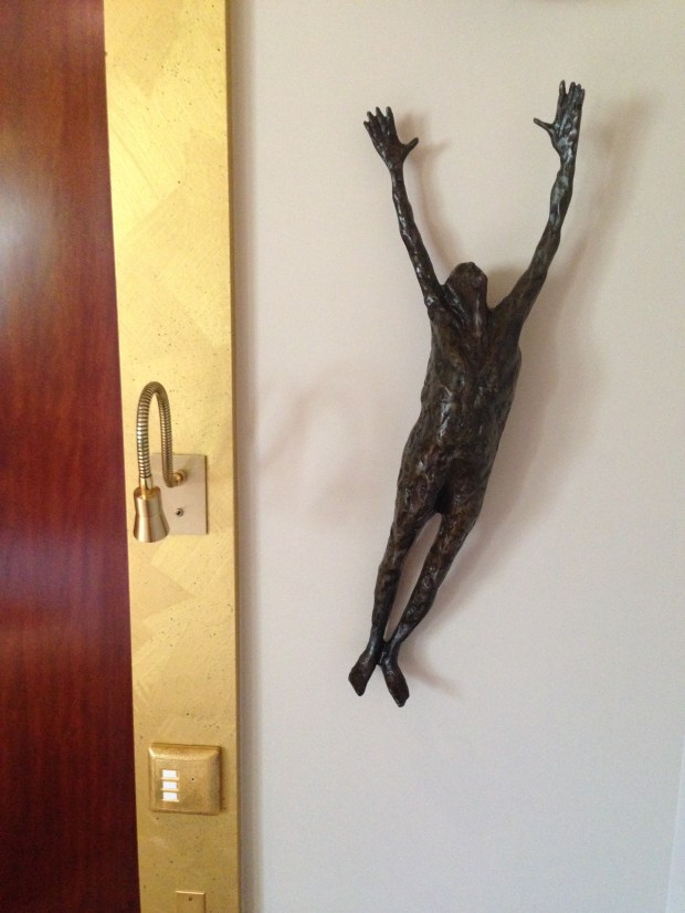 The skinny hanging man sculptures were all over the room and hotel