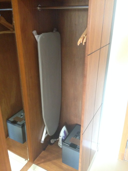 Closet, safe, ironing board, hangers