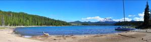 Elk Lake Bend Oregon Banner image with Mt Bachelor and a boat