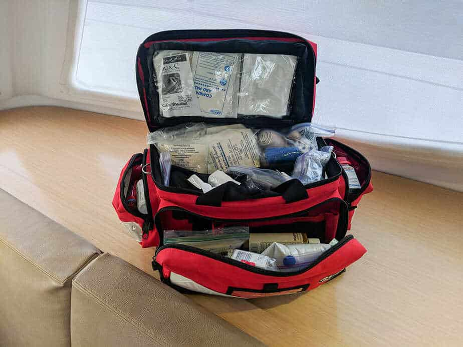 A photo of a fully stocked offshore medical kit with emergency supplies in a red EMT bag.