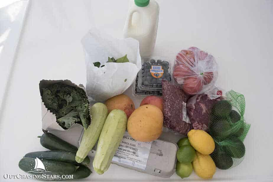 My goodies from the Coffs Harbour Market: blueberries, lemons, limes, mangoes, avocados, kale, cucumbers, zucchinis, eggs, mixed greens, tomatoes, beef, and milk.
