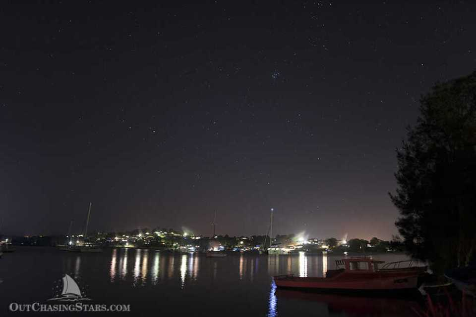 Starry Horizons on a mooring ball in Lake Macquarie off or the Wangi RSL and under the night sky.