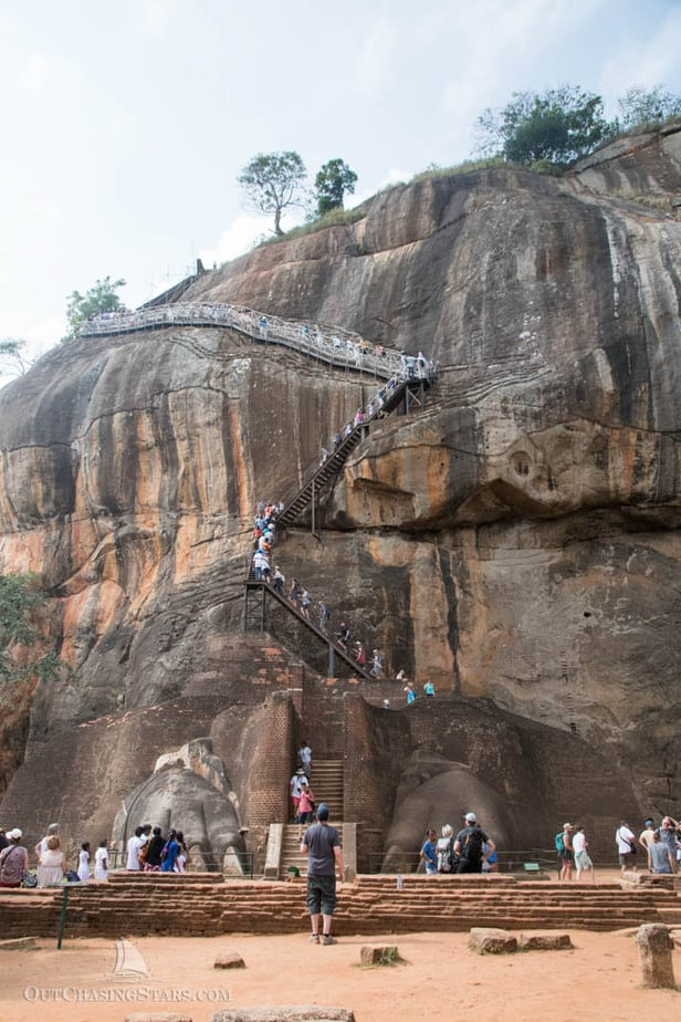 Lion gate and crowds at Sigiriya rock fortress.