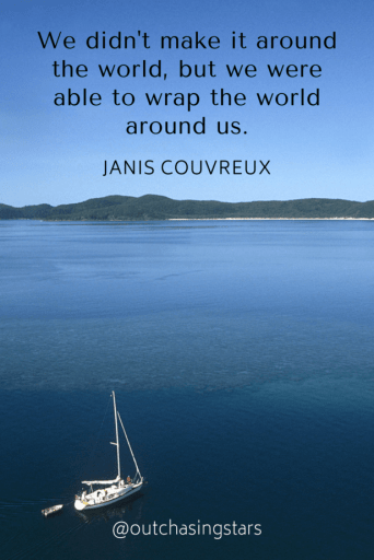 """A sailboat motoring in calm water with an island in the distance and the text:""""We didn't make it around the world, but we were able to wrap the world around us."""" - Jude Couvreux50+ Sailing QuotesComplied by Out Chasing Stars"""