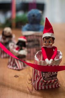 Elf on the shelf in a funflicks Sack Race beat vader