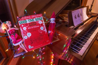 Elf on the Shelf and Barbie decorate the music stand for a late night singsong