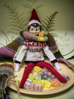 Elf on the shelf dressing as Doctor Who Tom Baker and Jelly Baby