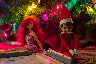 Elf on the Shelf playing scrabble with Red Head Barbie