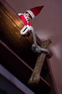Elf on the shelf with a dog bone
