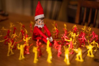 Elf on the shelf is surrounded by pirates and ninjas