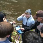 Students running a water quality test