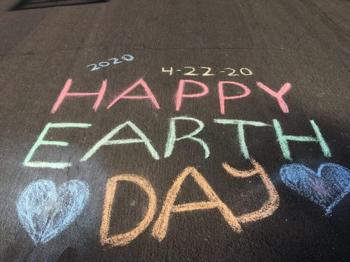 Earth Day Message written in chalk