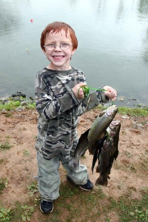 young angler with a bunch of trout