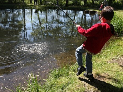 young angler pulling the fishing rod
